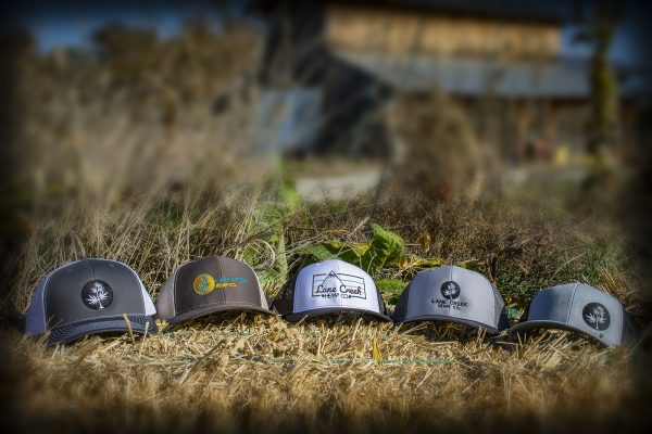 All-5-trucker-hats-on-Hay-Bale-w-Barn